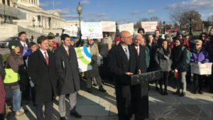 Photo of Ted Deutch, Charlie Crist, Francis Rooney, and a crowd of supporters at the introduction of the Energy Innovation and Carbon Dividend Act
